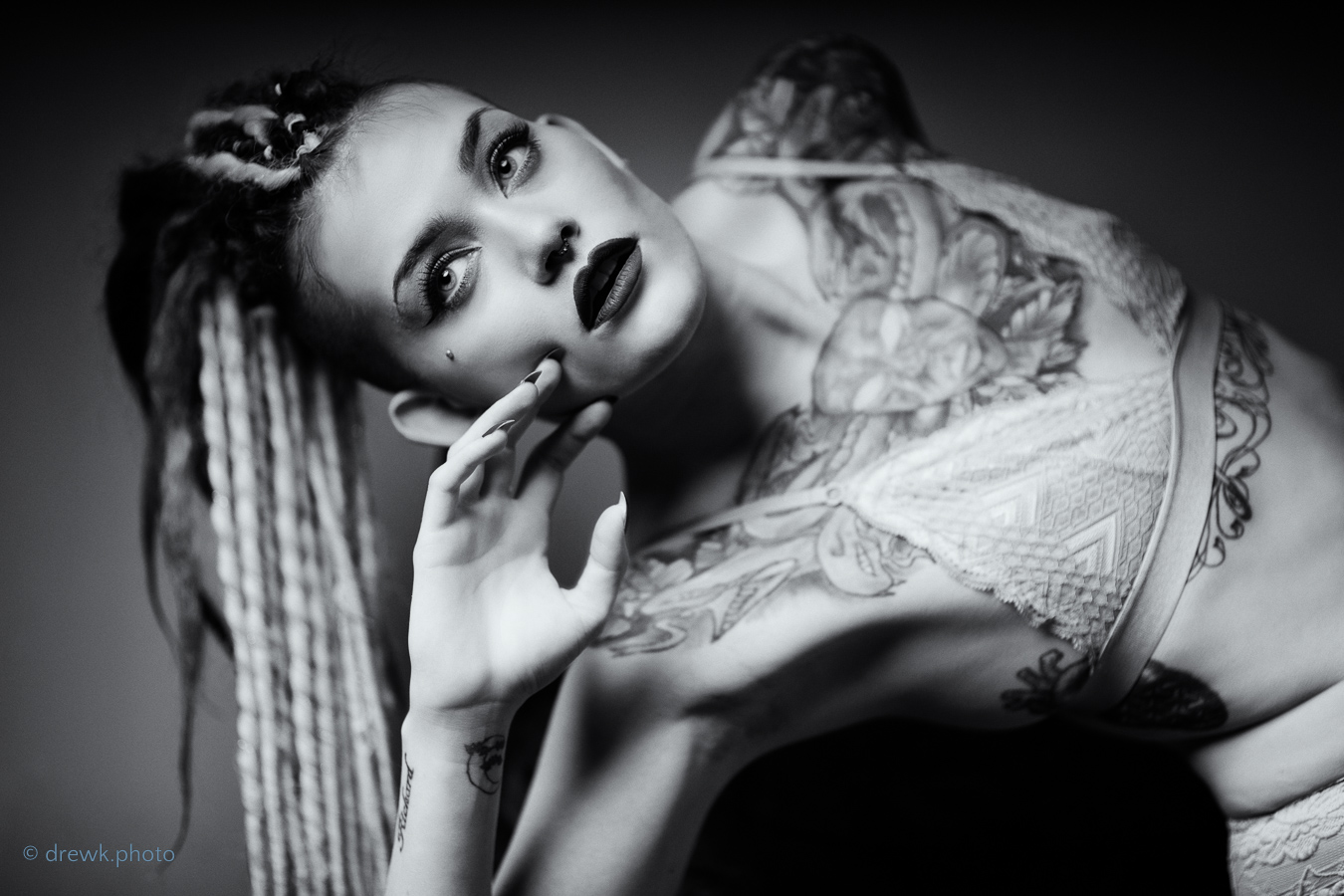 Model :Aura Aura\'s striking cheekbones and body art really lend themselves to a monochrome treatment on this shot.
